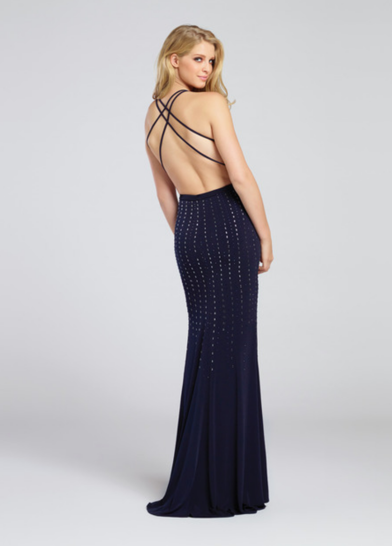 navy blue; sleeveless jersey fit and flare gown; vertically adorned with heat-set stone bodice; halter straps and crisscross back straps