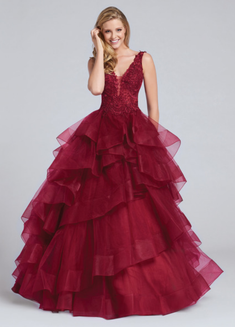 navy blue/royal blue/wine; sleeveless tulle ball gown with lace and heat-set stone bodice; plunging v-neck and an illusion modesty panel; low scooped back; voluminous asymmetrically layered and tiered tulle skirt
